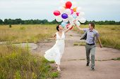 stock photo of latex woman  - Head and shoulders portrait of happy cheerful couple - JPG