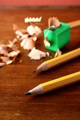 picture of pencils  - Photo of Two sharpened pencils and one in a pencil sharpener - JPG