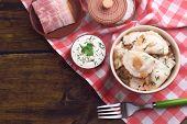foto of liver fry  - Tasty dumplings with fried onion in brown bowl - JPG