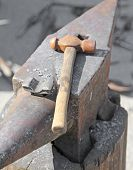 image of blacksmith shop  - Anvil and sturdy hammer in the workshop of the blacksmith - JPG