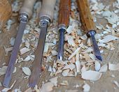 picture of chisel  - expert Carpenter chisels with wood chips after processing - JPG