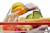 pic of grocery cart  - Shopping cart on white background full with groceries - JPG