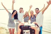 foto of waving hands  - summer - JPG