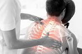 picture of physiotherapy  - Digital composite of Highlighted spine of man at physiotherapy - JPG