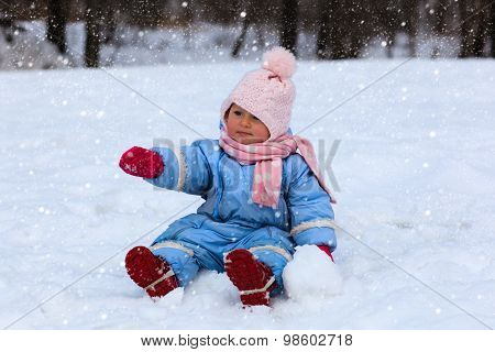cute little toddler girl in winter snow