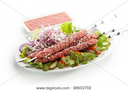 Marinated Beef Kebab with Onions and Herbs. Uncooked Meat