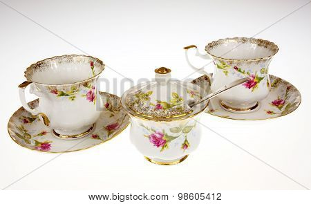 Two Porcelain, Decorative Cups And Sugar-bowl On Isolated White