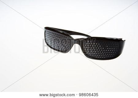 Pinhole Glasses On Isolated White