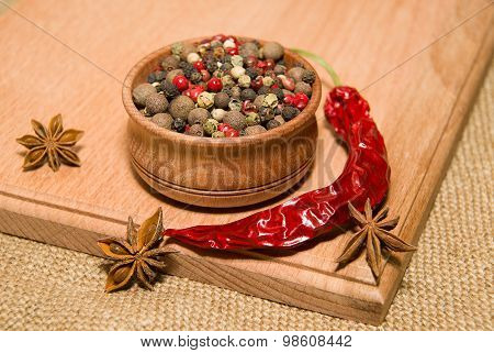 The Grains Of Pepper, Cilli And Star Anise On A Wooden Surface