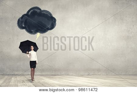 Bad luck and crisis concept with young businesswoman with black umbrella