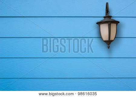 Old Lamp And Shera Plank Wall Blue.