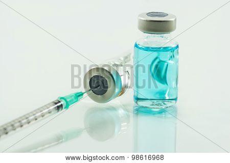 Medical Syringe And Medicine  Isolated On White Background