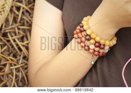 Woman Wearing A Black Shirt And Bracelet Jewelry.
