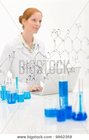 Woman Scientist In Laboratory With Laptop