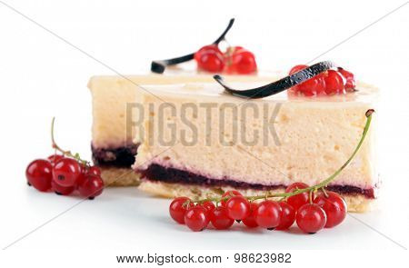 Tasty pieces of cheesecake with berries isolated on white