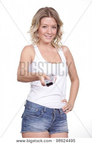 Young woman with TV remote control