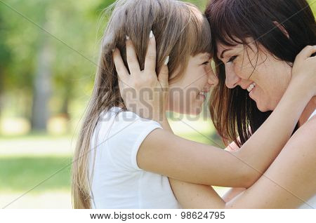 Tender Touch Of Happy Girl And Her Mother