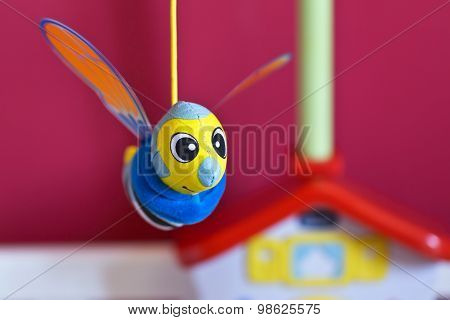Little Bee Hanging Above Baby Bed