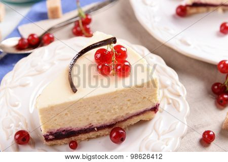 Tasty cheesecake with berries on table close up