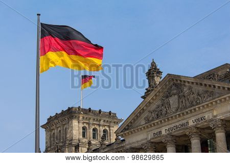 German flag on Reichstag building in Berlin: German parliament