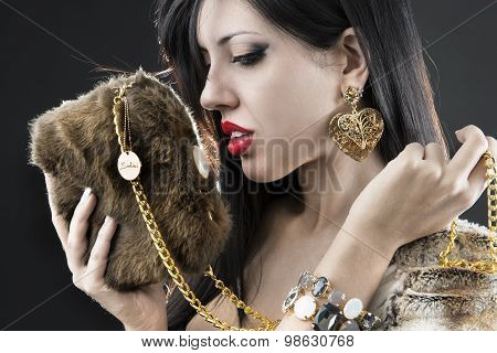 elegant fashionable woman with jewelry and bag