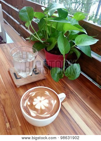 Relax With A Cup Of Coffee With Lovely Flower Caffe Latte Art