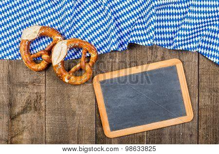 Blackboard With A Bavarian Diamond Pattern And Pretzels