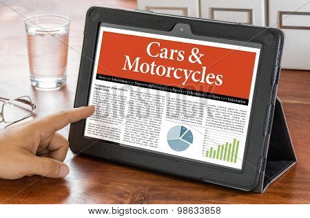 A Tablet Computer On A Desk - Cars And Motorcycles