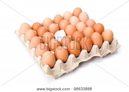 Egg Tray With One Broken Egg Shell In The Middle