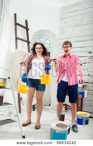 Young couple doing repair at home.