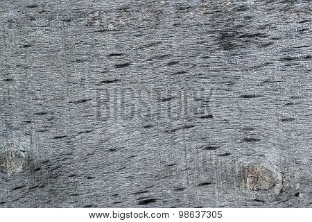 Texture Of The Old Cracked Blackened Plywood