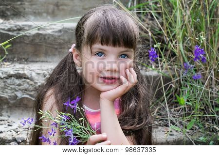 Dreamy Little Girl With A Bouquet On The Stairs