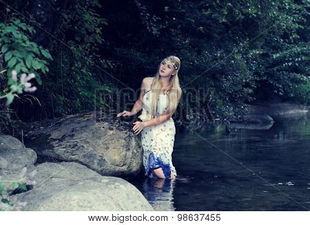 beautiful girl in the river