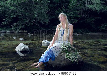 pretty blond girl near the river