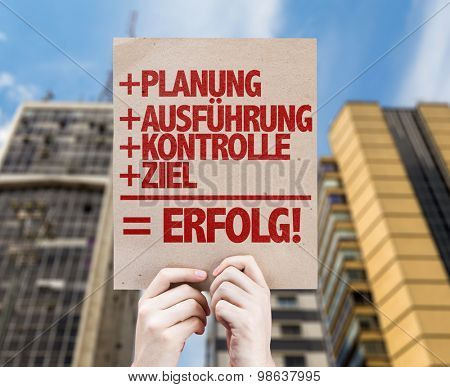 Planning + Execution + Control + Target = Success (in German) card with urban background