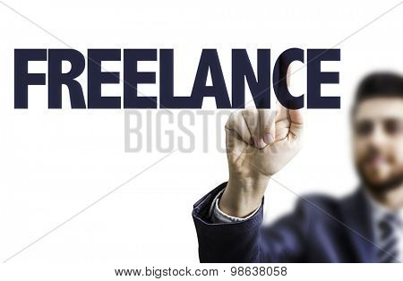 Business man pointing the text: Freelance