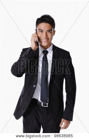 young smile businessman with mobile phone