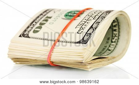 A lot of one hundred dollar bills tied rubber band isolated on white