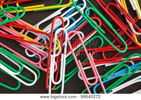 Paper Clips On A Black Background