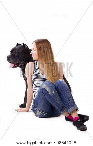 Girl Sits On Floor. Her Dog Cane Corso Sitting At Her. Look In The Side