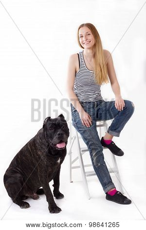 Girl Is Sitting On A Stepladder. Her Dog Cane Corso Next