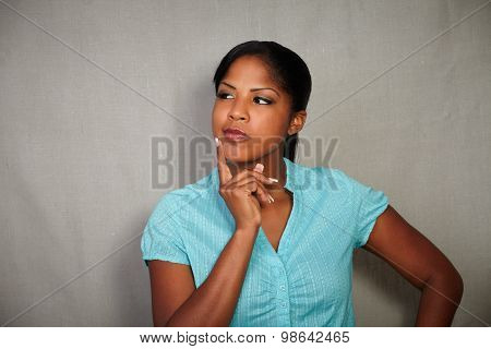 Pensive Woman Looking Away While Thinking