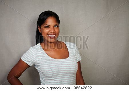 Charismatic Girl Standing Against Grey Background