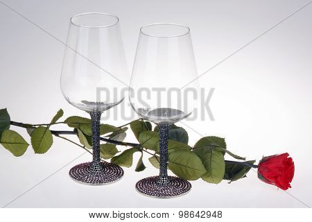 Close-up of wine glass with red rose