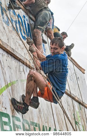 Sportsman storms big wall in extrim race. Tyumen.Russia