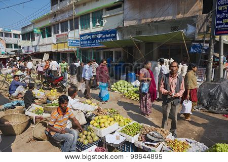 People walk by the local market in Bandarban, Bangladesh.