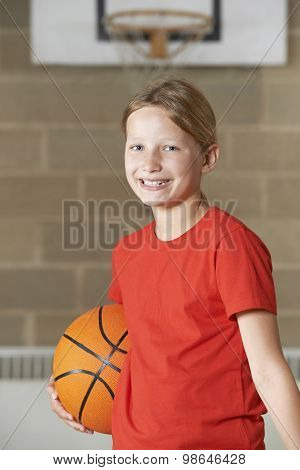 Portrait Of Girl Holding Basketball In School Gym
