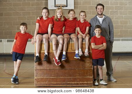 Portrait Of School Gym Team Sitting On Vaulting Horse