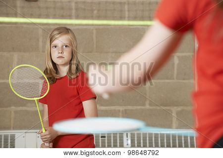 Two Girl Playing Badminton In School Gym