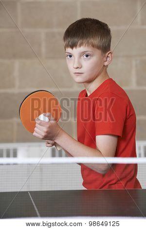 Boy Playing Table Tennis In School Gym
